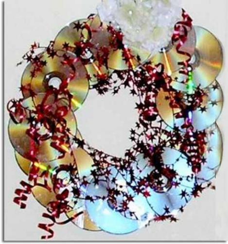 Corona navide a hecha con cd usados navidad - Manualidades con cd usados ...