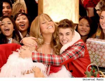 mariah carey y justin bieber villancicos 411x320 Justin Bieber visita DisneyWorld por navidad